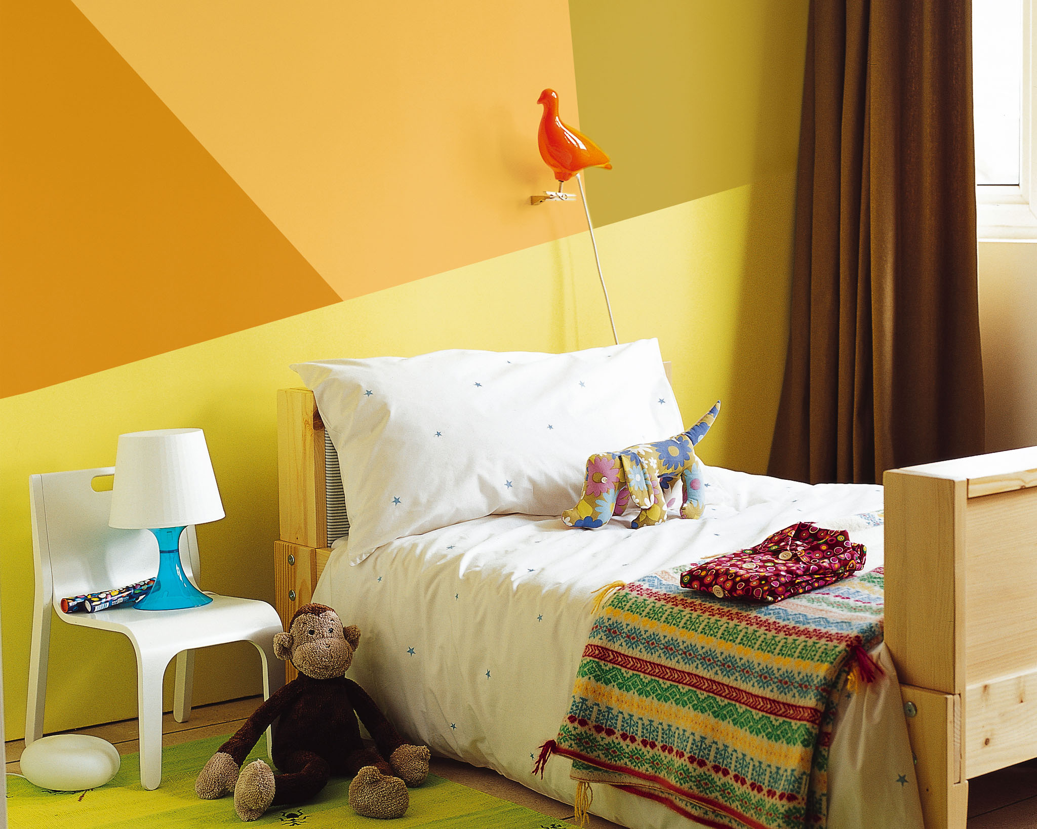 Paint your child's walls with colourful geometric shapes.