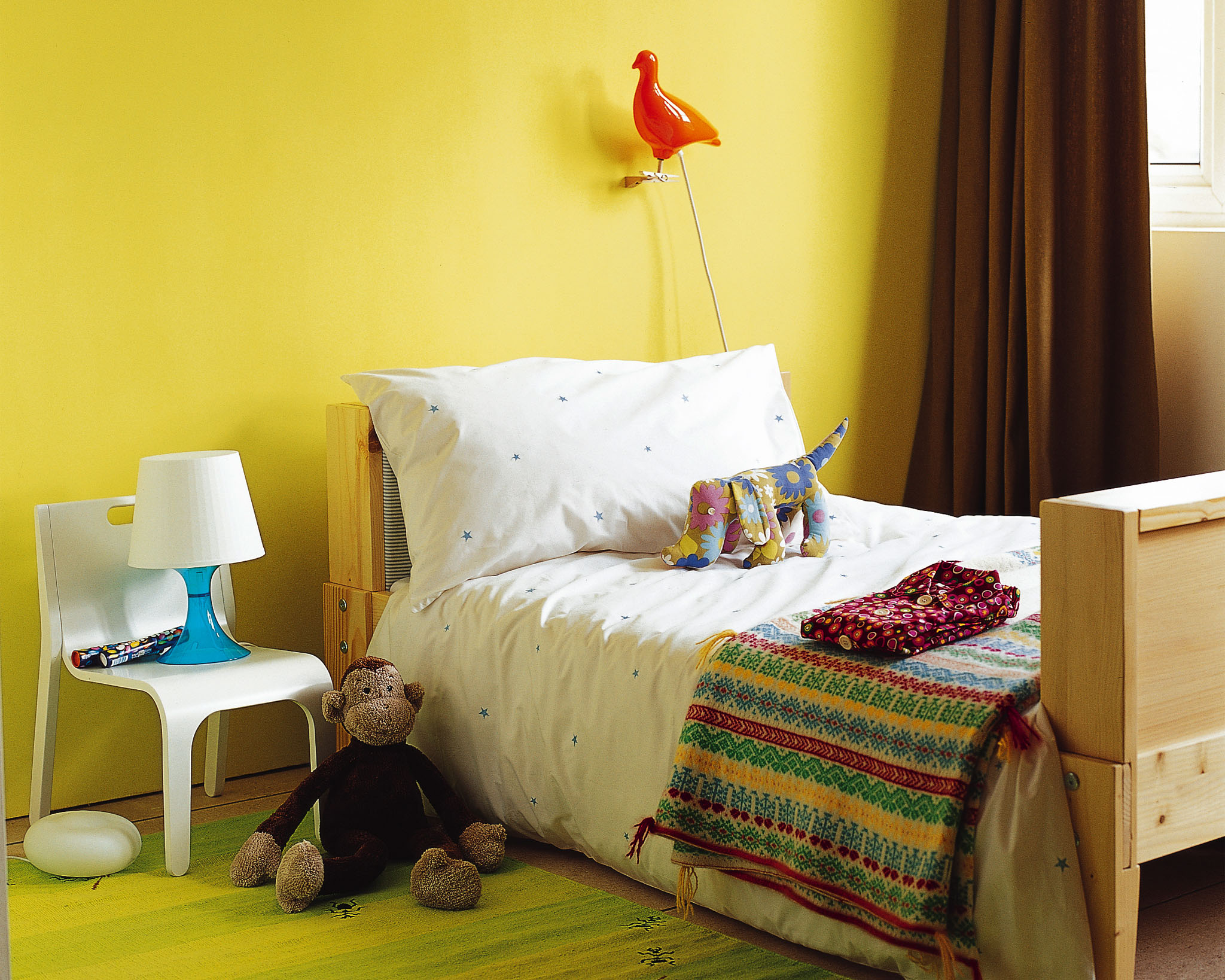 Try yellow in your kid's bedroom for a sunny, feel-good look