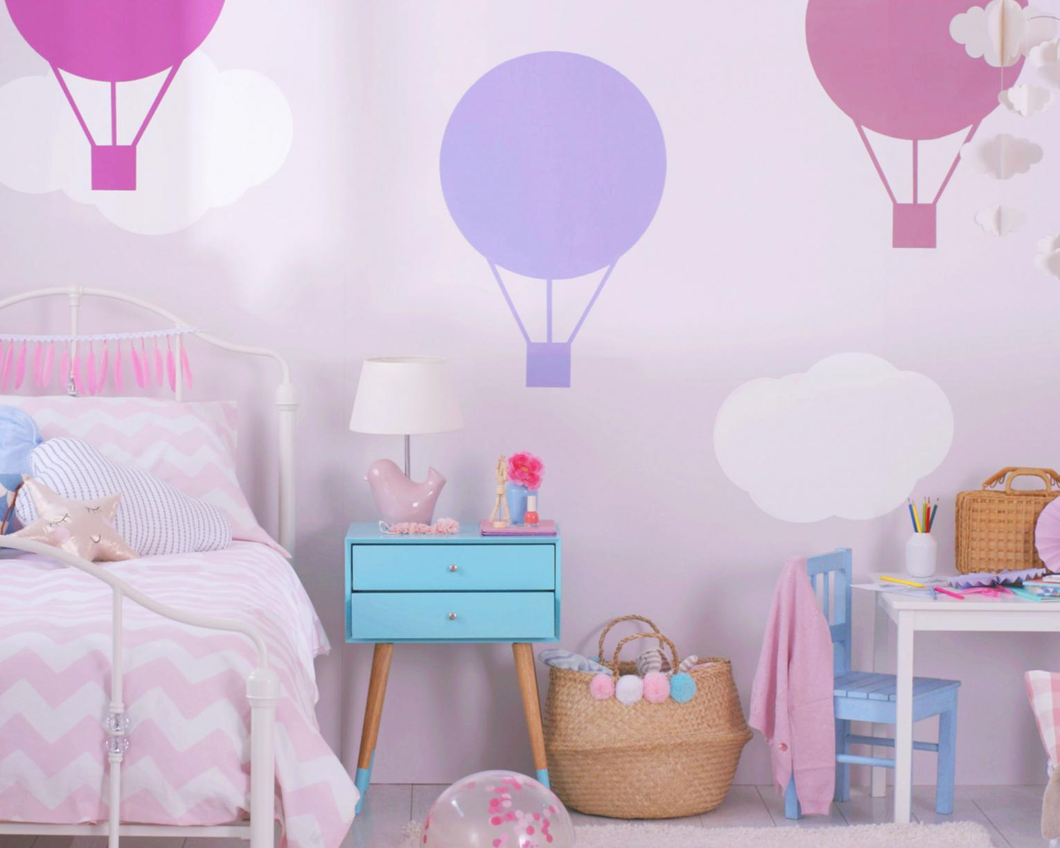 A combination of soft colours to create a balloon-themed girl's room